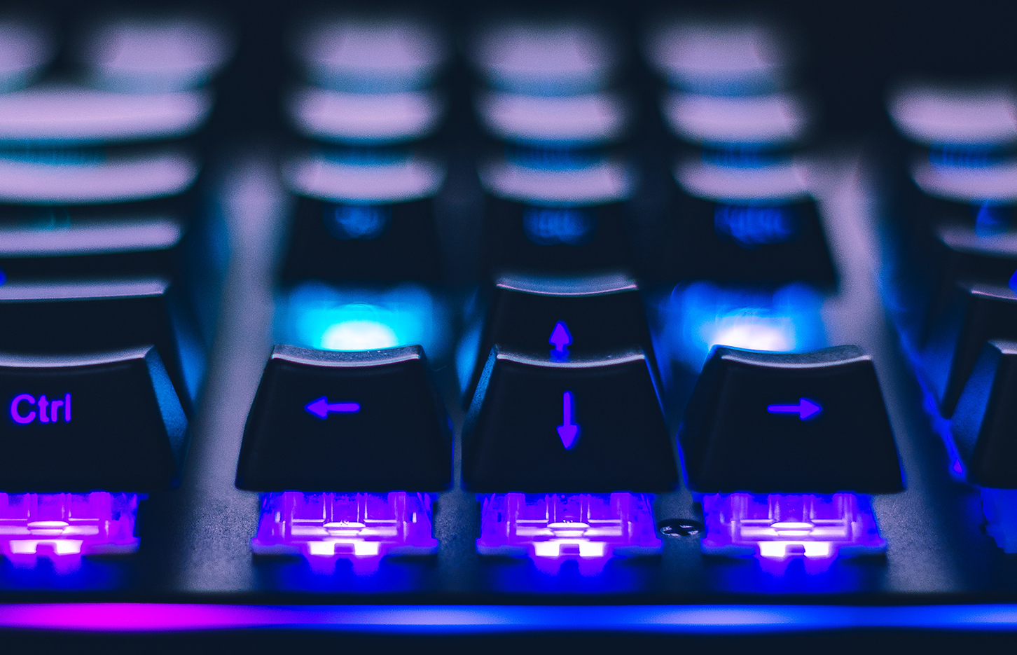 Close-up of arrow keys at a gaming keyboard