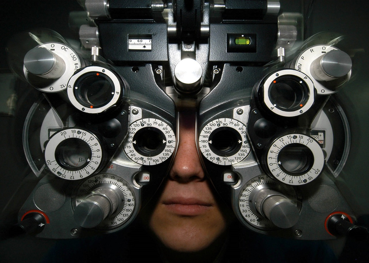 Person looks through eye measuring equipment